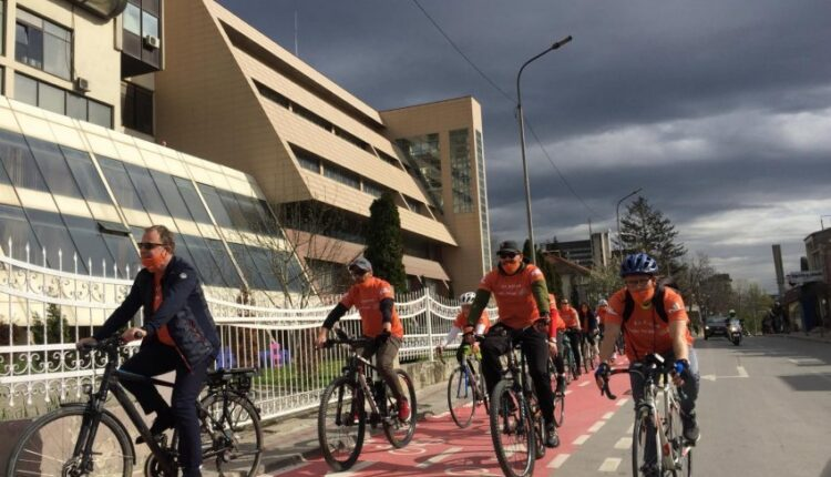 Dozens of cyclists march in honor of the Dutch National