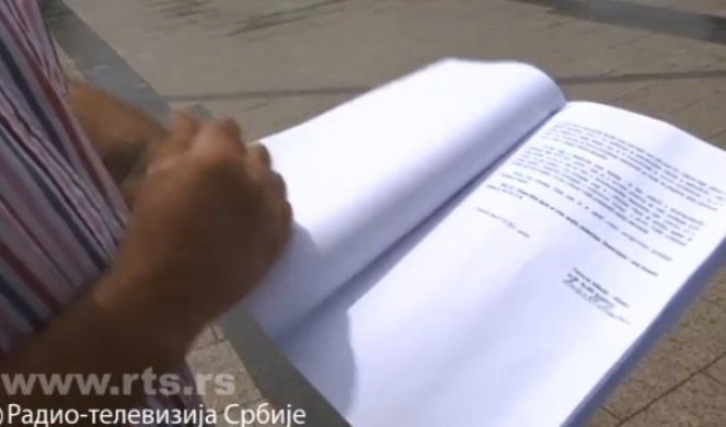 When Milutin's wife opened the envelope given to her by