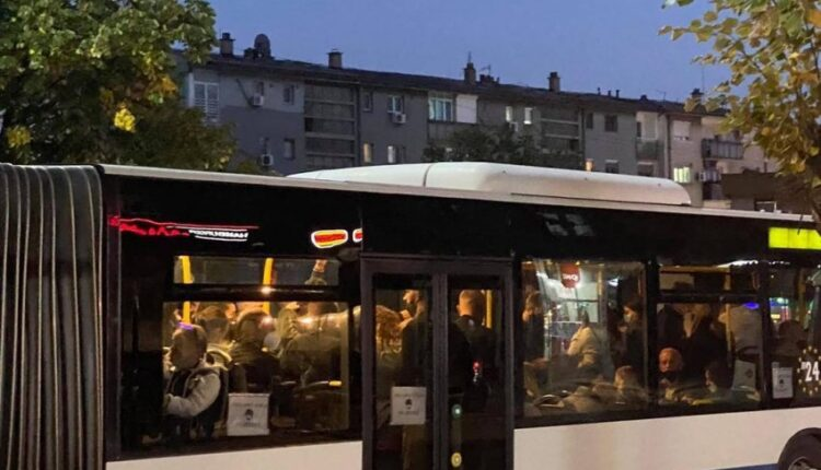 The overcrowded bus runs through the streets of Pristina